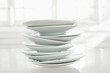 Stack of porcelain plates on table