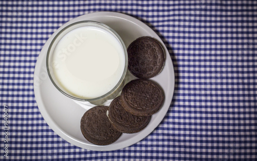 Milk and cookies on a blue and white map Canvas Print
