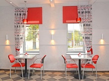 Interior Of Cafe With Red Chairs