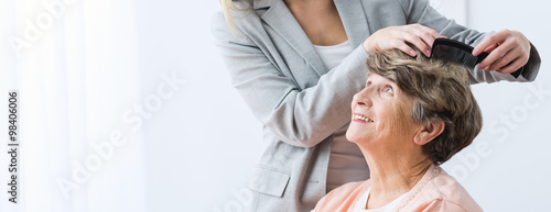 Tuinposter Kapsalon Making woman hairstyle