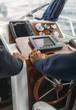 Spain, Asturias, Fishermen steering boat