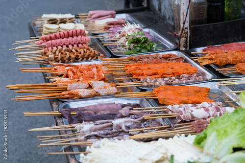 Photo  Oriental Asian barbeque sold at night street market in  China