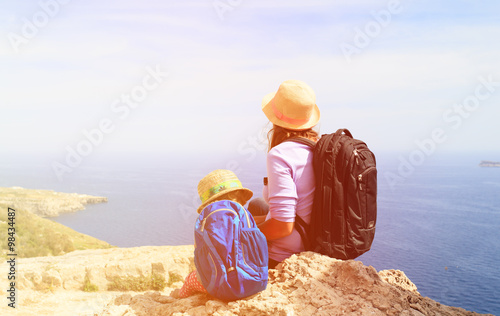 mother and daughter travel in mountains