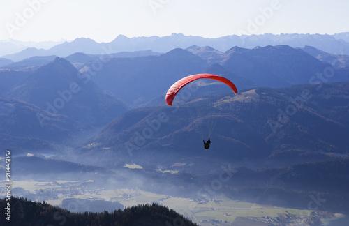 Austria, Person paragliding over Schafberg Mountain