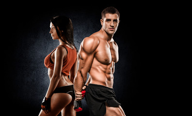 Fototapetaathletic couple poses for the camera