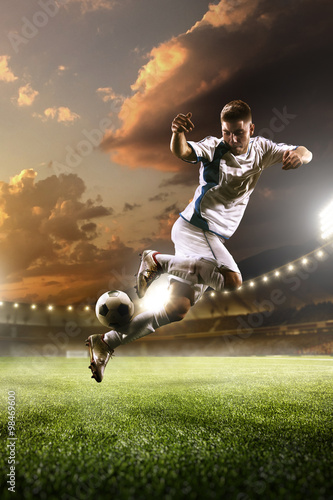 Photo  Soccer player in action on sunset stadium background
