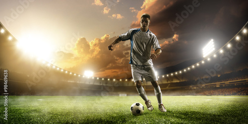 Photo  Soccer player in action on sunset stadium panorama background