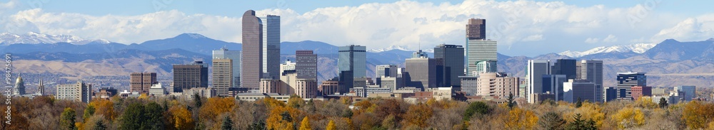 Fototapeta Denver, Colorado Skyline. Very large panorama of downtown Denver with Rocky Mountains in the background.