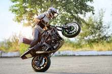 Always Practicing. Extreme Biker Showing His Talents In Stunt On The Road Soft Smudged Focus