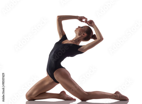 Fotografia  Gymnastics exercise over white isolated background