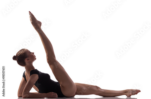 Fotografija Gymnastics exercise over white isolated background