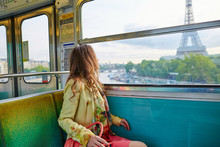 Beautiful Young Woman Travelling In A Train Of Parisian Underground