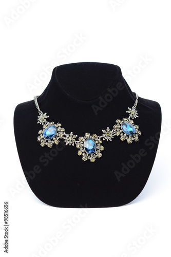 Fotografija  vintage necklace with blue gems on a mannequin