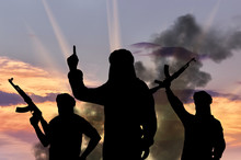 Silhouette Of Men With Rifles Against Cloudy Sky During Sunset