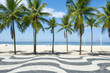 Iconic sidewalk tile pattern with palm trees at Copacabana Beach in Rio de Janeiro, Brazil