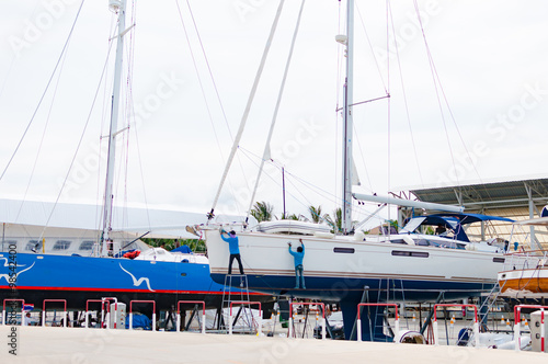 Fotografia  Luxury sailboat on a maintenance process in a shipyard