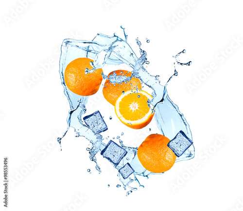 Foto op Canvas In het ijs Water splash with fruits and ice cube isolated on white backgroud. Fresh orange