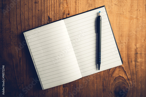 Fotografie, Tablou  Open notebook with blank pages and pencil