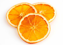 Three Dried Orange Slices From Above On White Background