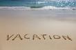 Vacation written on beach