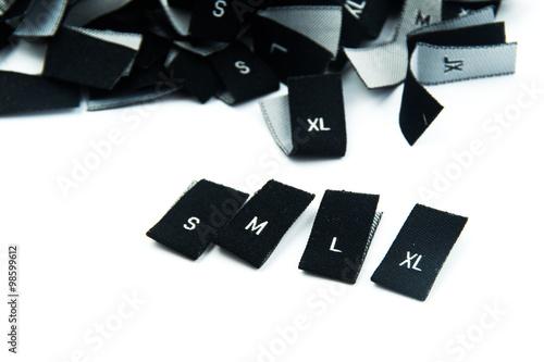 Photo  black fabric clothing size labels