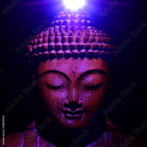 Buddha face with light Wallpaper Mural