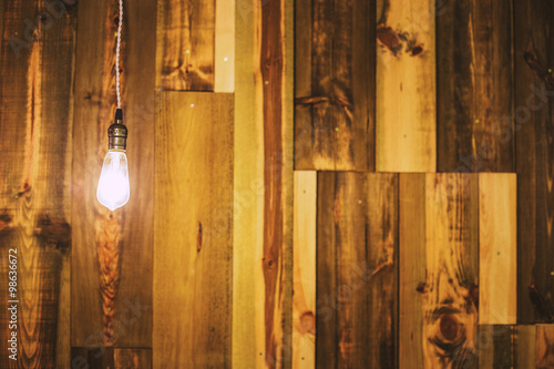Photo  Vintage lamp on wooden wall