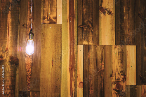 Vintage lamp on wooden wall Canvas Print
