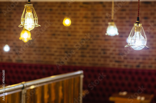 Photo  Vintage incandescent bulb on brick wall background