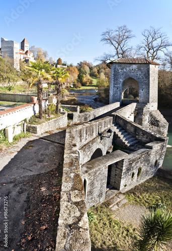Valokuvatapetti Legend Bridge details in Sauveterre-de-Bearn medieval village