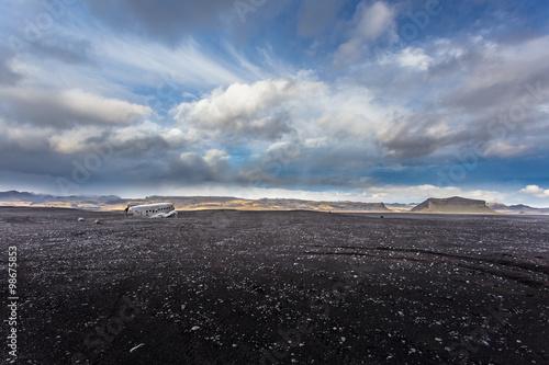 Airplane wreckage on black sand beach. Douglas Dakota DC3, US na Poster