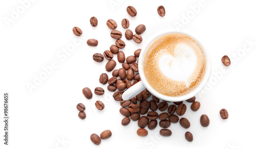 Leinwand Poster Small cup of cappuccino with coffee beans