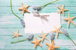 Marine items and flowers on wooden background.