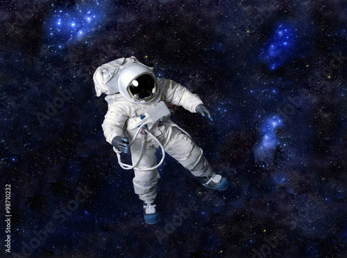 Photo  Astronaut floating in dark space.