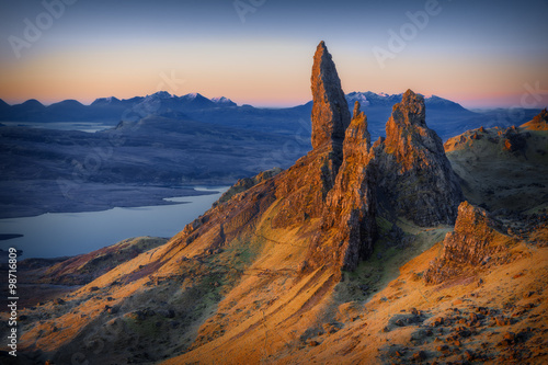 Fotografie, Obraz First light at sunrise over Old Man of Storr, Isle of Skye, Scotland, UK, on a c