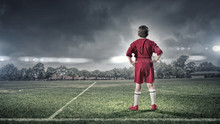 Kid Boy On Soccer Field