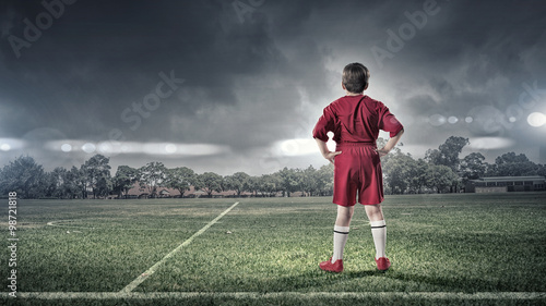 kid boy on soccer field