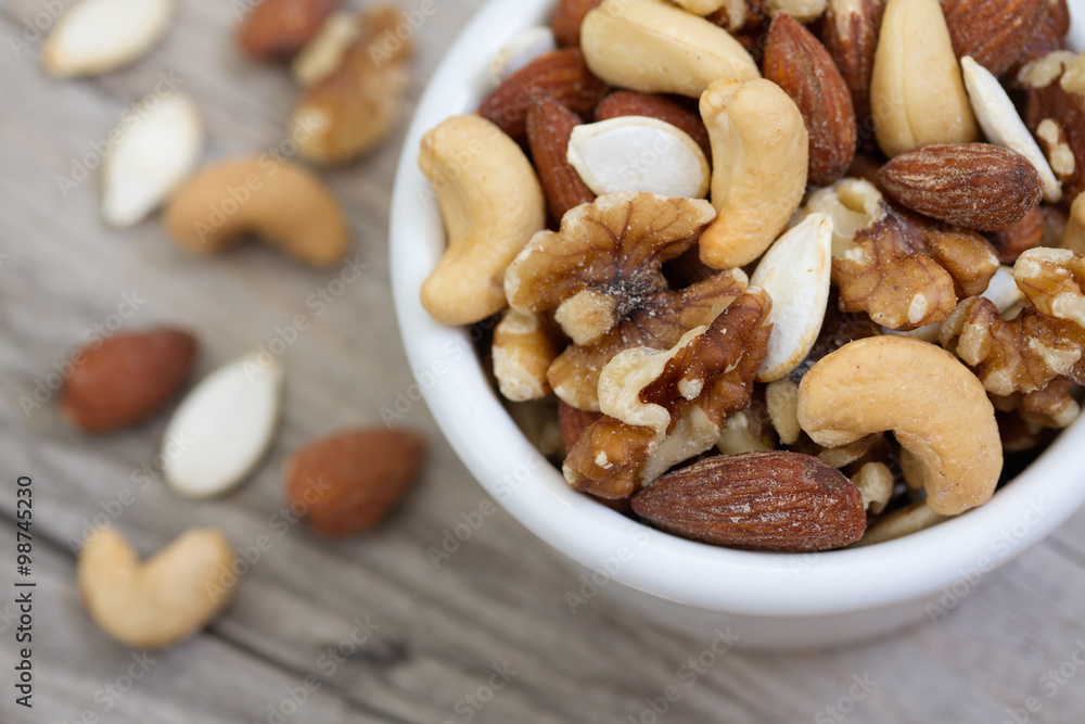 Fotografía Bowl of Mixed Nuts on Rustic Wooden Table