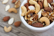 Bowl Of Mixed Nuts On Rustic W...