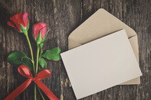 Blank White Greeting Card With Red Rose