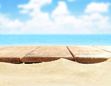 Sand With Wooden Planks On Sea Background
