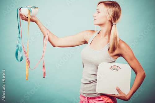 Fotografia  Girl with scales measuring tapes. Weight loss.