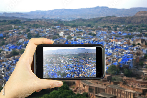 blue city JODHPUR, India. Taking photo on smart phone concept. Poster