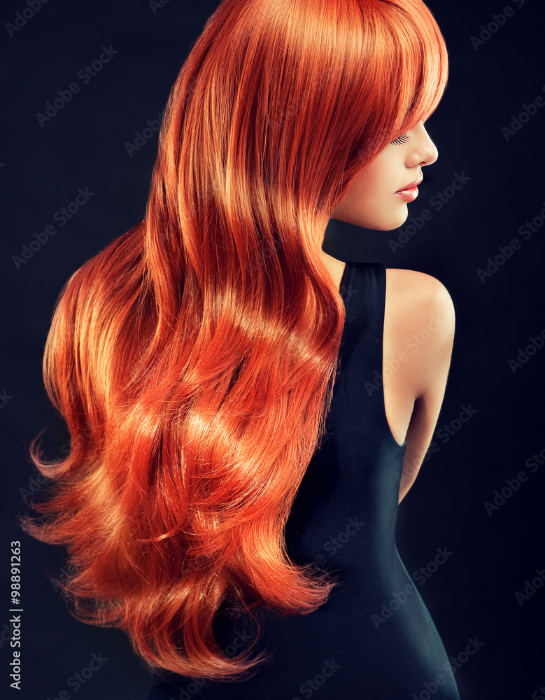 Beautiful model girl  with long red curly hair