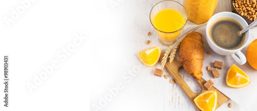 Fotografie, Obraz  Croissants, coffee and orange juice, top view. Breakfast concept