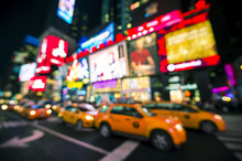 Defocus View Of Times Square Signage, Traffic, And Holiday Crowds In The Lead-up To New Year's Eve In New York City, USA