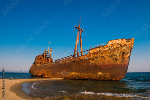 Poster Shipwreck Old Ship. Ancient shipwrecks in the sea with sunset background. Dimitrios shipwreck at Selinitsa beach near Gytheio, Greece