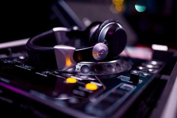 Fototapeta na wymiar Headphones on the DJ board