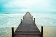 Wooden pier toward the fresh breeze sea