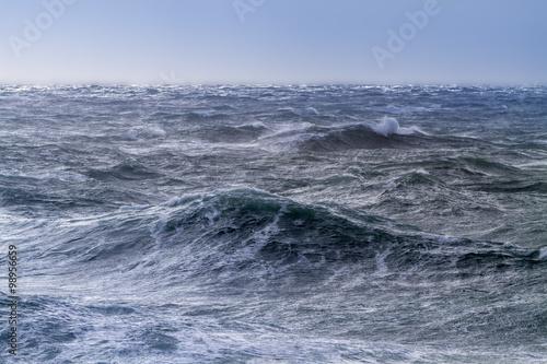 Staande foto Zee / Oceaan Rough sea on a sunny day